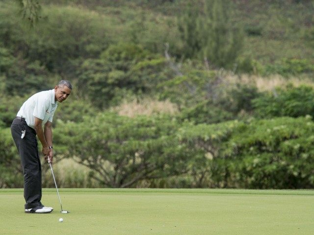 More Obama golf (Nicholas Kamm / AFP / Getty)