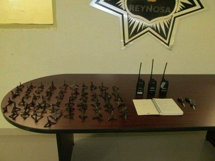 Various radios and tire spikes used by Gulf Cartel  lookouts called hawks.