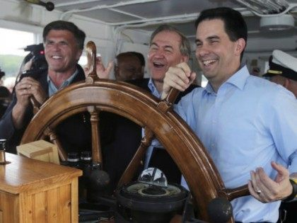 Wisconsin Gov. Scott Walker (right) takes the wheel with former Virginia Gov. Jim Gilmore (center) and former Maryland Gov. Bob Ehrlich at an event Friday on New Hampshire's Lake Winnipesaukee.