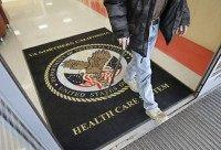 FILE - In this April 2, 2015, file photo, a visitor leaves the Sacramento Veterans Affairs Medical Center in Rancho Cordova, Calif. The number of veterans seeking health care but ending up on waiting lists of one month or more is 50 percent higher now than it was a year …
