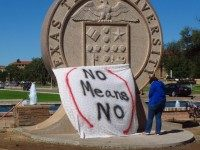 "FILE - In this Wednesday, Oct. 1, 2014 file photo, Texas Tech freshman Regan Elder helps drape a bed sheet with the message ""No Means No"" over the university's seal at the Lubbock, Texas campus to protest what students say is a ""rape culture"" on campus. A picture of a …"