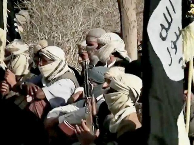 "YEMEN, - : An image grab taken on April 16, 2014 from a video released on March 29, 2014 by Al-Malahem Media, the media arm of Al-Qaeda in the Arabian Peninsula (AQAP), allegedly shows AQAP jihadists listening to their chief Nasser al-Wuhayshi at an undisclosed location in Yemen. Wuhayshi has pledged in a rare video appearance to pursue the war against the Western ""crusaders"" everywhere possible. AFP PHOTO/HO/AL-MALAHEM MEDIA"