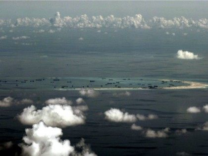 IN FLIGHT, IN FLIGHT : This aerial photograph taken from a military aircraft shows alleged on-going reclamation by China on Mischief Reef in the Spratly group of islands in the South China Sea, west of Palawan, on May 11, 2015. The Spratlys are considered a potential Asian flashpoint, and claimant …