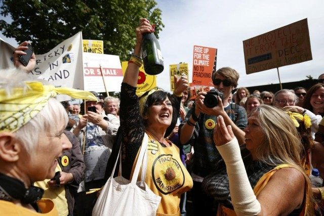 Anti-fracking protesters celebrate a rejected fracking planning application during a demonstration outside County Hall in Preston