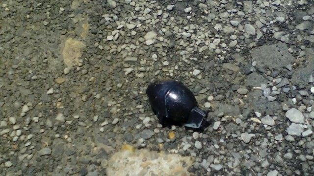 Unexploded grenade thrown by suspected Gulf Cartel members in the border city of Matamoros
