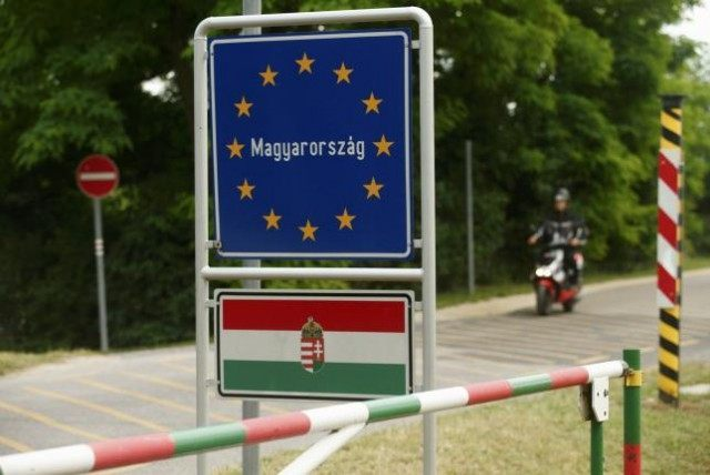 A motorcyclist passes the border between Austria und Hungary near St. Margarethen
