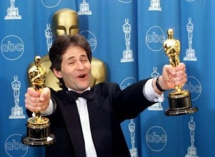 James Horner holds up two Oscars after winning for Best Original Song and Original Dramatic Score fo..