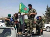 The Kurdish fighters of the People's Protection Units via AP