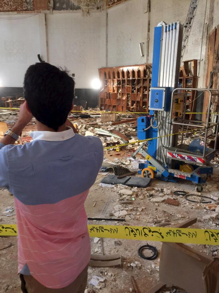 A resident looks at the damage at the Imam Sadiq Mosque after a bomb explosion, in the Al Sawaber area of Kuwait City June 26, 2015. REUTERS/Kuwait News Agency