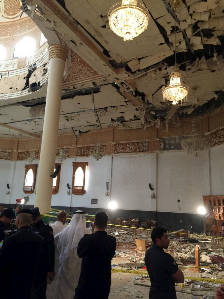 Police inspect the Imam Sadiq Mosque after a bomb explosion, in the Al Sawaber area of Kuwait City June 26, 2015. REUTERS/Kuwait News Agency