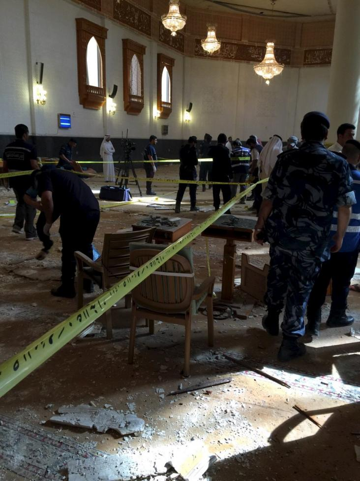 Inspectors work at the Imam Sadiq Mosque after a bomb explosion, in the Al Sawaber area of Kuwait City June 26, 2015. REUTERS/Kuwait News Agency