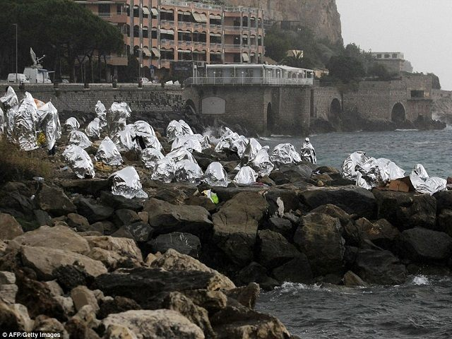 Migrants camped out on the rocks at Ventimiglia