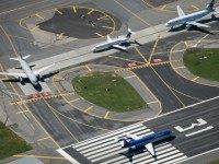 Airplanes wait to take off at LaGuardia Airport in New York.