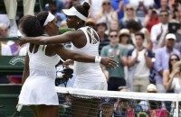 Serena Williams of the U.S.A. embraces Venus Williams of the U.S.A. after winning their match at the Wimbledon Tennis Championships in London