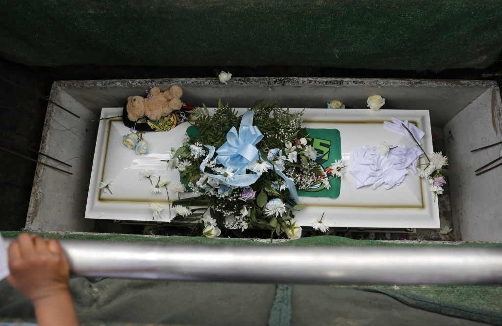 Flowers, a stuffed bear and other mementos cover the casket of Amari Brown. (AP Photo/Christian K. Lee)