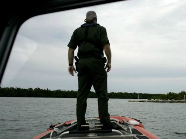 U.S. Border Patrol agent Dan Schaefer looks at a small island, where smugglers are known to unload their human cargo, as he rides on a Coast Guard boat January 30, 2007 in Marathon, Florida. Along the Florida Keys the Border Patrol depends on interagency cooperation to help in their primary …