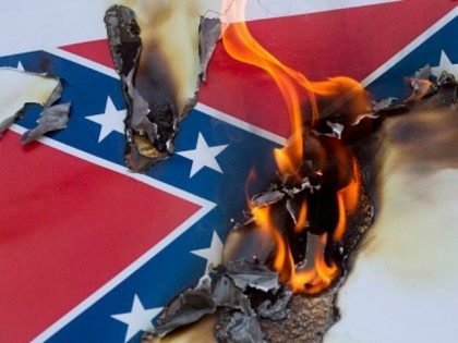 Protesters burn a paper Confederate flag during a rally on June 23, 2015 in Los Angeles, California. The protesters were supporting the call by South Carolina Gov. Nikki Haley to remove the Confederate flag from the grounds of the State Capitol.