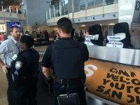 Relentless animal rights activists attempted to make waves at San Diego airport's baggage claim with two orca-suited protesters on Thursday, but few passers-by seemed to notice their antics as law enforcement officers pulled them off the conveyer.