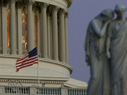 A flag at the U.S. Capitol flies at half staff after President Barack Obama ordered the action while speaking on the shootings at the Sandy Hook Elementary School December 14, 2012 in Washington, DC. Obama called for 'meaningful action' in the wake of the latest school shooting that left 27 …