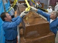 Garry Hine, left, and Gary Wychocki help move a giant chocolate bar to a scale Tuesday, Sept. 13, in Chicago.