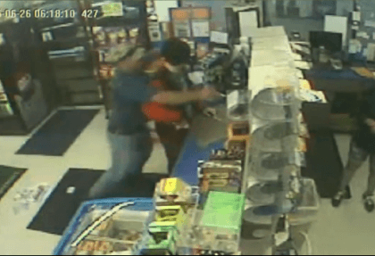 Fireman Grabs Robber - Security Camera Screenshot