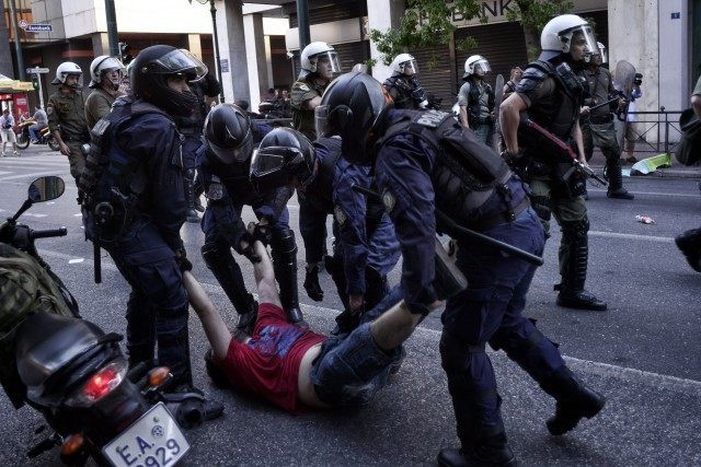 An anti-austerity demonstrator is arrested in Syntagma Square during an anti-Austerity rally on July 3, 2015 in Athens, Greece. Milos Bicanski/Getty Images