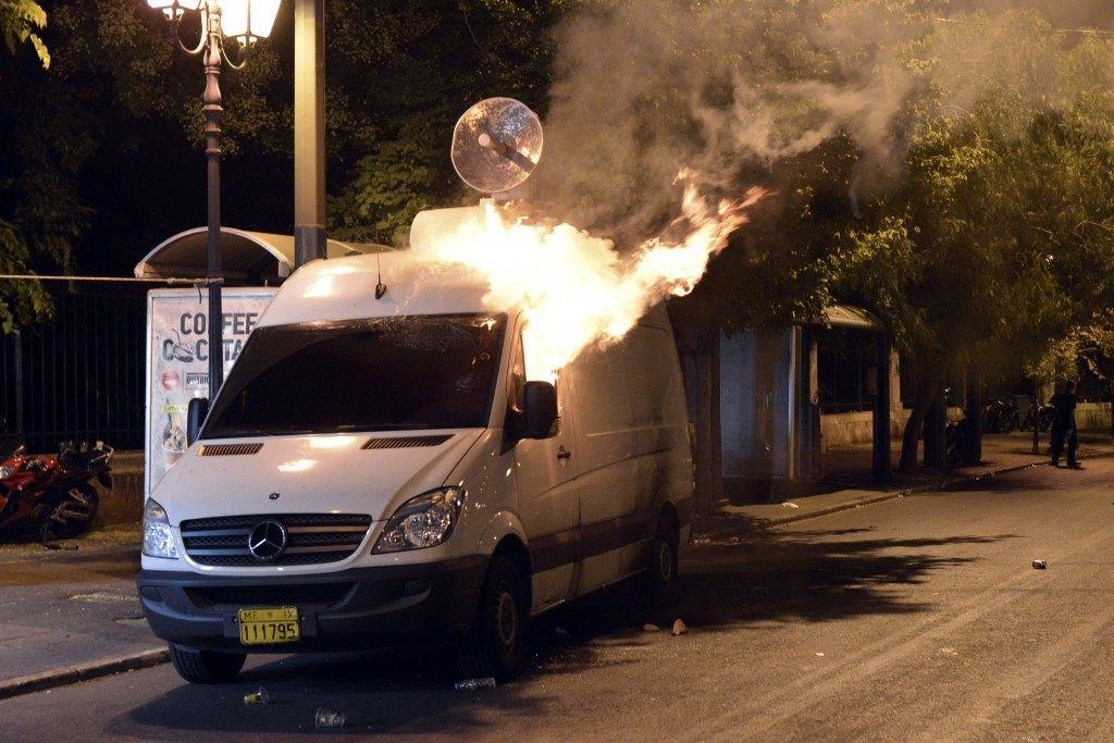 Protesters set fire to a TV van (Milos Bicanski/Getty Images)