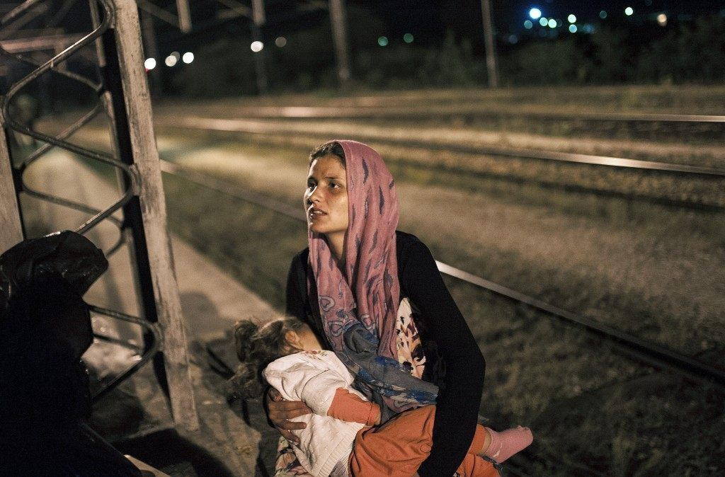 A migrant woman holds her child (ROBERT ATANASOVSKI/AFP/Getty Images)