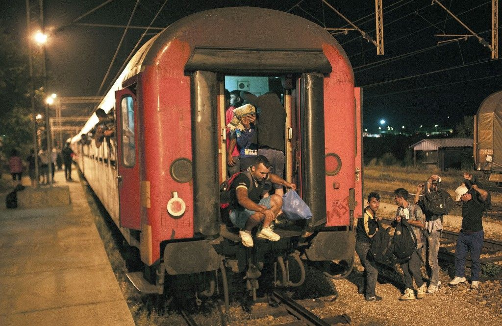 Migrants get out from a train (ROBERT ATANASOVSKI/AFP/Getty Images)