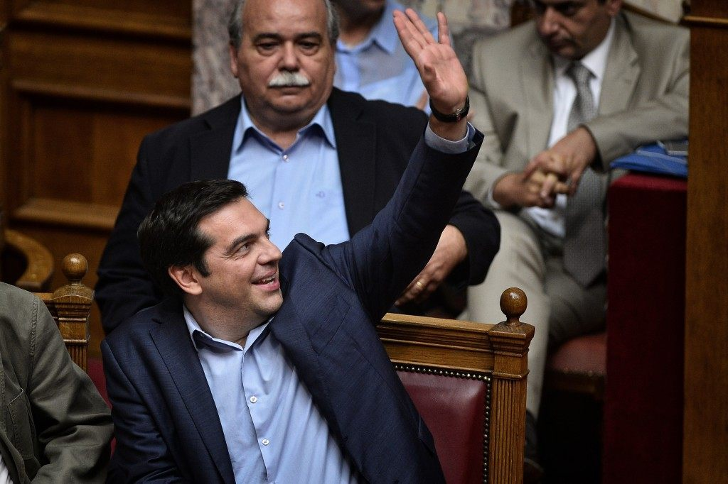 Greek  prime minister Alexis Tsipras  votes during a session at the  Greek parliament in  Athens (LOUISA GOULIAMAKI/AFP/Getty Images)