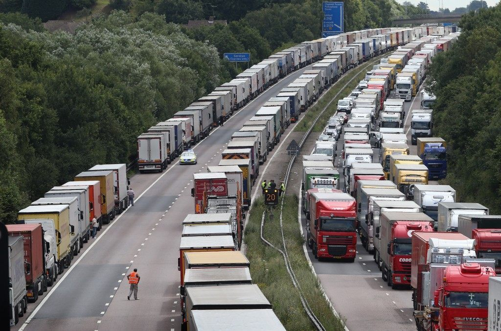 Trucks line up on the M20 during Operation Stack on July 30, 2015 near Ashford, England. (Peter Macdiarmid/Getty Images)