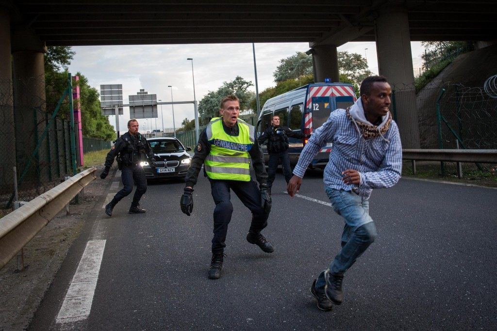 A man runs away from Gendarmerie (Rob Stothard/Getty Images)