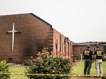 Investigators with the Bureau of Alcohol, Tobacco and Firearms examine the burned ruins of the Mt. Zion AME Church July 1, 2015 in Greeleyville, South Carolina. Federal and state agencies are investigating a recent string of church fires in the South that have occured since the church massacre in nearby Charleston, South Carolina. Mt. Zion AME was burned twenty years ago by members of the Ku Klux Klan.