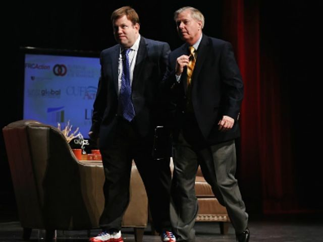 Republican presidential hopeful Senator Lindsey Graham (R) of South Carolina walks across the stage with Frank Luntz at The Family Leadership Summit at Stephens Auditorium on July 18, 2015 in Ames, Iowa. According to the organizers the purpose of The Family Leadership Summit is to inspire, motivate, and educate conservatives.