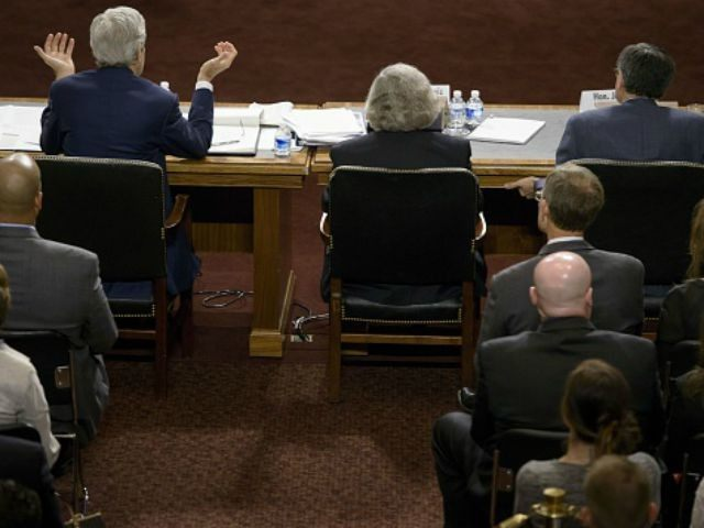 US Secretary of Energy Ernest Moniz (C) and US Secretary of the Treasury Jacob Lew listen while US Secretary of State John Kerry (L) speaks during a hearing of the Senate Foreign Relations Committee on Capitol Hill July 23, 2015 in Washington, DC. US Secretary of State John Kerry, US …