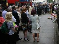 Buses pass by as family members attend a remembrance ceremony at the spot where 13 people were killed in the London bombings on July 7, 2015 in London, England.Today is the tenth anniversary of the 7/7 bombings, when four suicide bombers struck transport system in central London on Thursday 7 July 2005, killing 52 people and injuring more than 770 in simultaneous attacks.