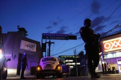 Police patrol near the main office of the newspaper El Norte in Monterrey