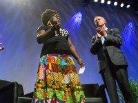 Former Gov. Martin O'Malley (D-MD) (R), and moderator Jose Antonio Vargas (R), listen to Tia Oso, the National Coordinator for the Black Immigration Network, during an interruption to O'Malley's speech, at the Netroots Nation 2015 Presidential Town Hall with at the Phoenix Convention Center July 18, 2015 in Phoenix, Arizona. …