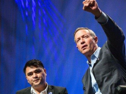 Former Gov. Martin O'Malley (D-MD) (R) speaks of his commitments at the Netroots Nation 2015 Presidential Town Hall with moderator Jose Antonio Vargas at the Phoenix Convention Center July 18, 2015 in Phoenix, Arizona. The Democratic presidential candidate spoke of the criminal justice system in income inequality before being interrupted by demonstrators yelling 'Black Lives Matter' and challenging his record as mayor and governor.
