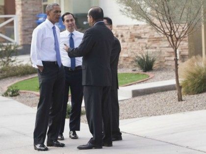 President Barack Obama speaks with Edmundo Hidalgo (R), CEO of Chicanos Por La Causa (CPLC) and David Adame (2nd R) of CPLC, alongside Housing and Urban Development Secretary Julian Castro (L), during a neighborhood stop to highlight his administration's home purchase and refinancing policies in Phoenix, Arizona, January 8, 2015. . AFP PHOTO / SAUL LOEB (Photo credit should read