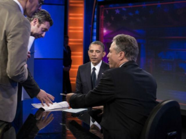 President Barack Obama and host Jon Stewart sit during a break in a live taping of the 'Daily Show with Jon Stewart' on October 18, 2012 in New York, New York. Obama is traveling to New Hampshire and New York to attend campaign events before appearing on the 'Daily Show' …
