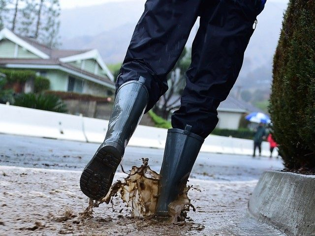Rain boots puddles (Frederic J. Brown / AFP / Getty)