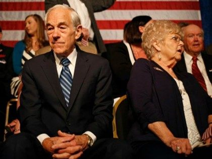 Rep. Ron Paul (R-TX) sits on stage before watching his son Sen. Rand Paul (R-KY) announce his candidacy for the Republican presidential nomination during an event at the Galt House Hotel on April 7, 2015 in Louisville, Kentucky. Originally an ophthalmologist, Paul rode the Tea Party wave to office in 2010.
