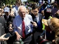 Democratic presidential candidate Sen. Bernie Sanders, I-Vt., speaks to reporters after speaking to federal contract workers at a rally on Capitol Hill in Washington, Wednesday, July 22, 2015, to push for a raise to the minimum wage to $15 an hour. (