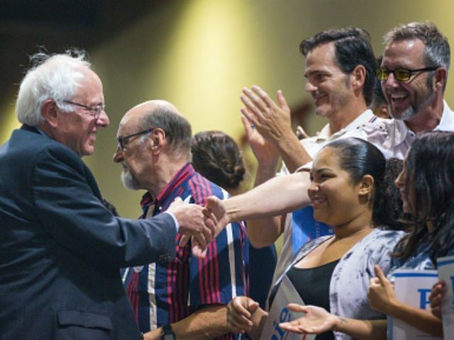 U.S. Sen. Bernie Sanders (I-VT) greets supporters during a rally at the Phoenix Convention Center July 18, 2015 in Phoenix, Arizona. The Democratic presidential candidate spoke on his central issues of income inequality, job creation, controlling climate change, quality affordable education and getting big money out of politics, to more …