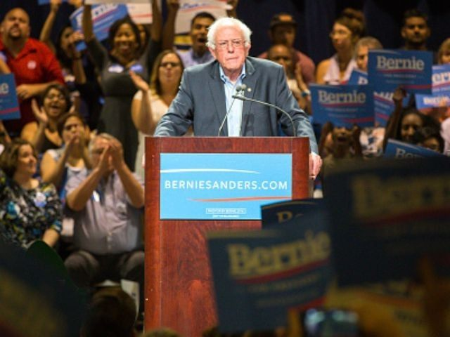 U.S. Sen. Bernie Sanders (I-VT) speaks to the crowd at the Phoenix Convention Center July 18, 2015 in Phoenix, Arizona. The Democratic presidential candidate spoke on his central issues of income inequality, job creation, controlling climate change, quality affordable education and getting big money out of politics, to more than …
