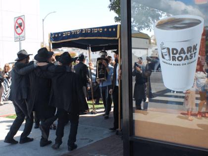 Celebration outside Dunkin Donuts (Joel Pollak / Breitbart News)