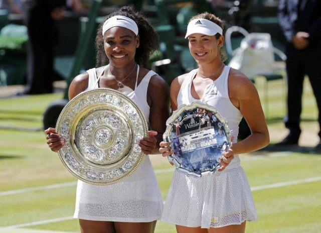 Winner Serena Williams of the U.S.A and runner up Garbine Muguruza of Spain show off their trophies after their Women's Final Match at the Wimbledon Tennis Championships in London