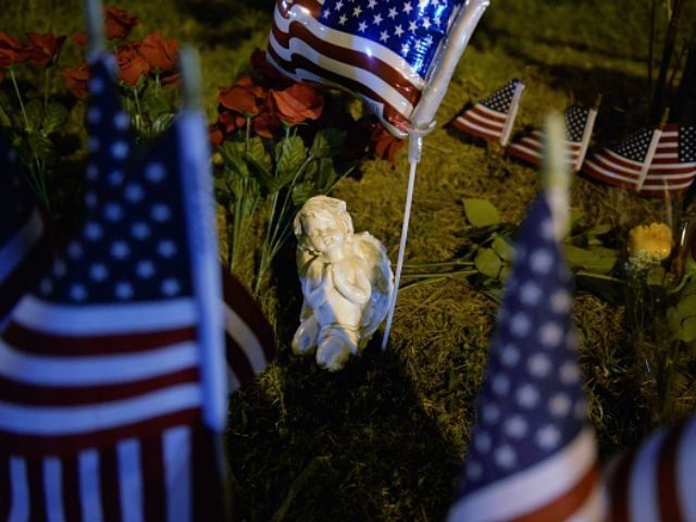 An angel statue sits in a makeshift memorial near the scene of a shooting at a Armed Forces Career Center/National Guard recruitment office on July 16, 2015 in Chattanooga, Tennessee. According to reports, Mohammod Youssuf Abdulazeez, 24, opened fire on a military recruiting station at a strip mall and then …