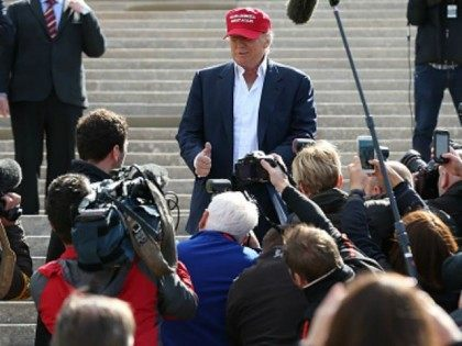 Media surround US Presidential Candidate Donald Trump as he visits his Scottish golf course Turnberry on July 30, 2015 in Ayr, Scotland. Donald Trump will answer questions from the media at a press conference where reporters will be limited to questions just about golf. (Photo by